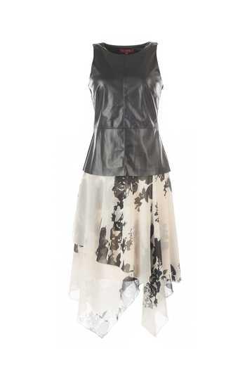 Robe de soirée buste uni cuir  jupe asymétrique imprimée.