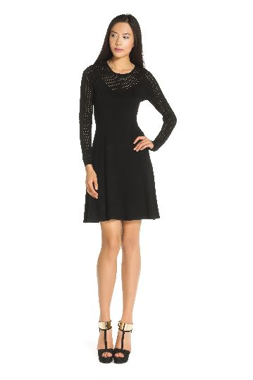 Long sleeve knitted dress in 78% viscose.